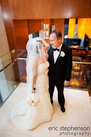 Elegant_bride_and_groom_at_denver_Four_Seasons.jpg