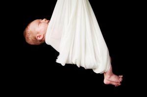 newborn_in_sling.jpg