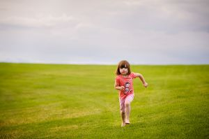 young_girl_running_in_park.jpg